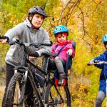 family-cycling-golden-autumn-park-active-father-kids-ride-bikes-family-sport-fitness-outdoors_146539-2364
