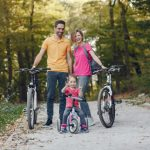 family-with-bicycle-summer-park_1157-33543