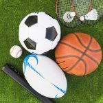overhead-view-different-type-sports-equipment-green-turf_23-2147924662