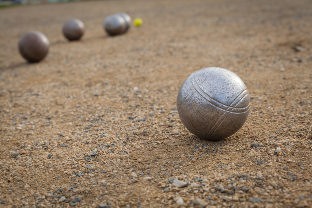 petanque-balls-sandy-pitch-with-other-metal-ball-background_155027-366