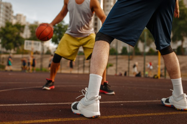 two-players-center-basketball-field-outdoor-court_266732-11410